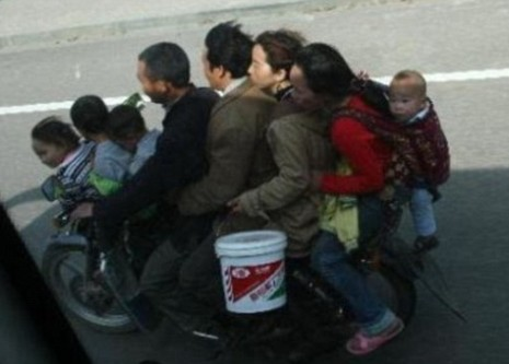 Motorcycle-Loaded-With-Many-People-01